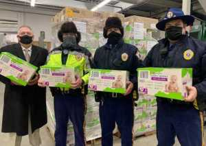 Captain Wall, Recruit Kasper, Trooper Iverson, and Trooper Kimura as they receive the pallets of diapers destined for distribution in rural Alaska.