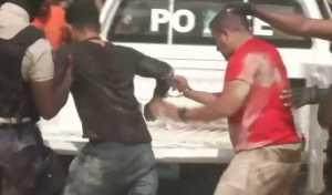 Two detainees in Haiti. Image-CBS video screenshot