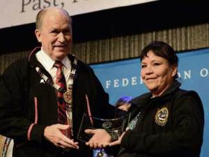 Kelly Fields accepting award from Governor Walker at AFN. Fields was joined by Cynthia Erickson and Anna Bill as winners of the 2018 Shirley Demienieff Award. Image-State of Alaska