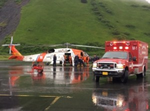 Coast Guard and emergency medical personnel transfer patients from an Air Station Kodiak MH-60 Jayhawk helicopter to an ambulance in Kodiak. Image-USCG