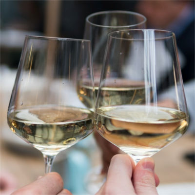 People making a cheers with wine glasses