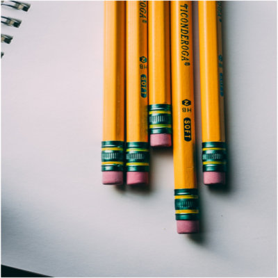 Pencils sitting on a notebook