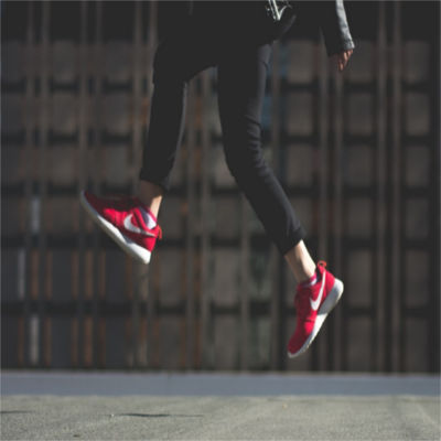 A person's feet jumping off the ground