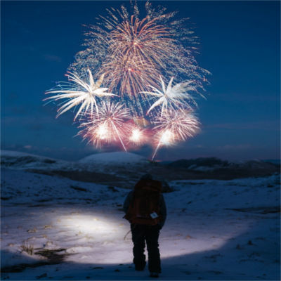 A person watching fireworks explode