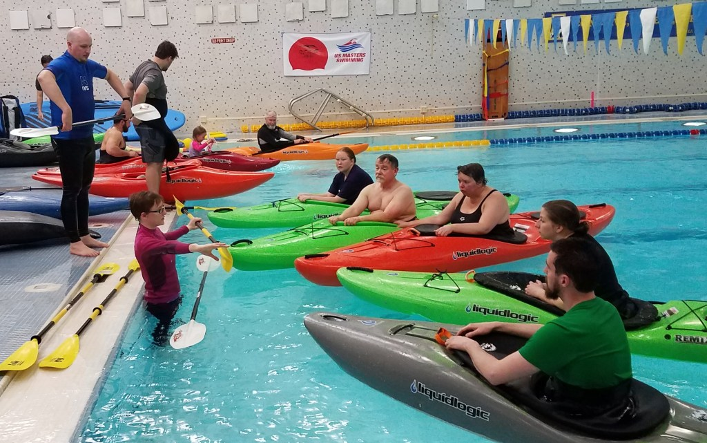 Alaska Dream Adventures instructors demonstrating techniques in pool