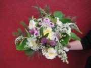 Wild Alaska bridal bouquet with garden roses, lavender button mums, wildflowers, alder, spruce, salal, seeded eucalyptus and a four-leaf clover   designed by Natasha Price of Alaskaknitnat.com