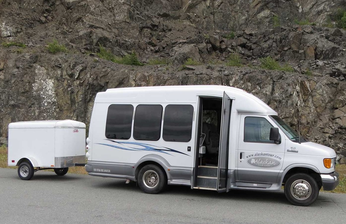 alaskan tour guides bus and luggage trailer