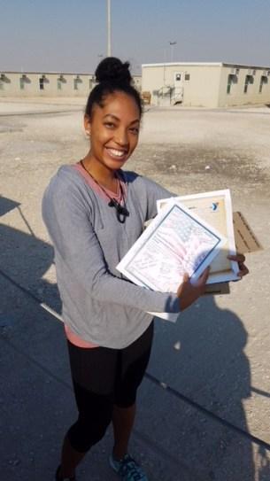 Deployed Service Member holding letter