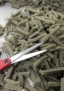 pile of licorice-shaped fish skins and scissors