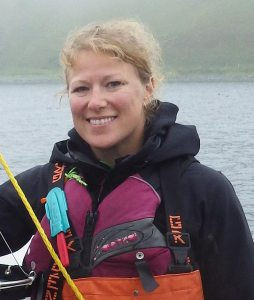 Woman in fishing gear smiling