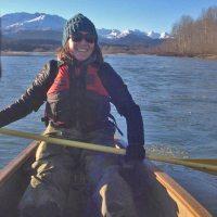 Young woman in canoe holding oar