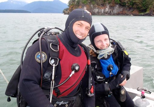 Man and woman on boat in scuba gear