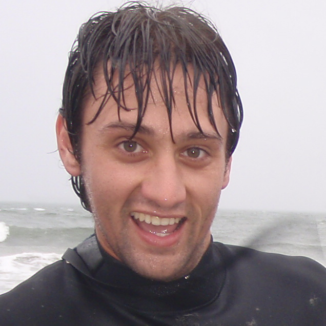 closeup of man with wet hair and ocean background