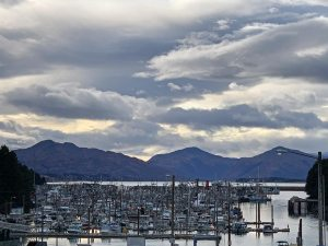 Looking down at Kodiak Harbor with mountains and dramatic skies