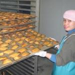 photo of woman processing salmon