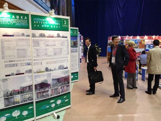 Fellow juror Jure Kotnik surveys exhibition of kindergarten designs in Yakutsk, my