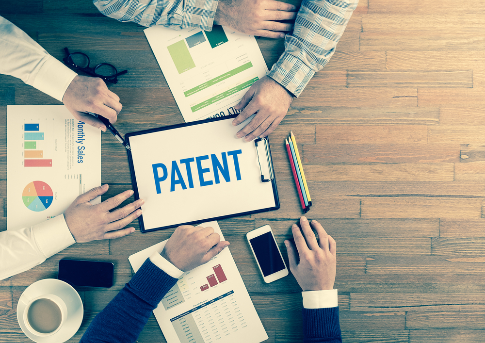 Can a corporate officer file a patent in his name?