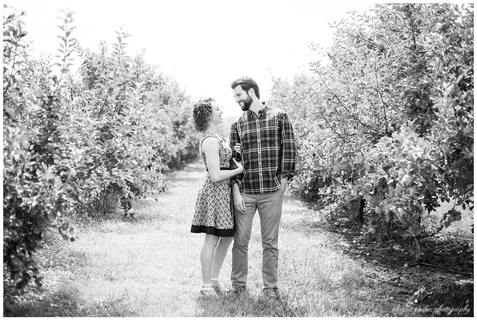 black and white image of couple looking at each other at lynd's fruit farm
