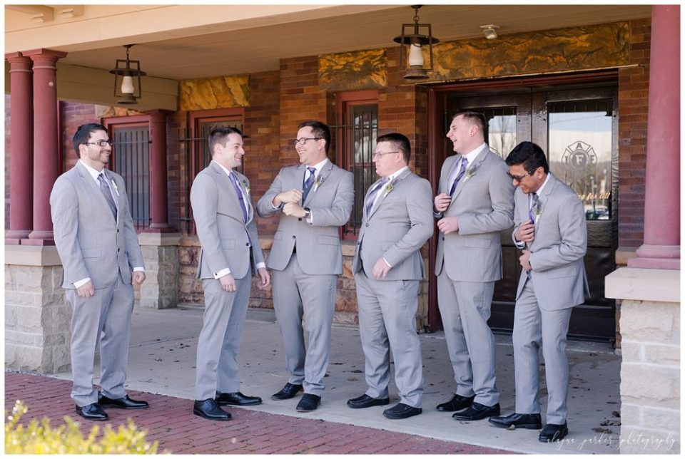 A picture of a candid view of the groom laughing with his groomsmen before the wedding begins at Sation 67 in downtown Columbus by Alayna Parker Photography  - Columbus  wedding photographers