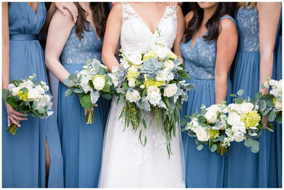 A picture of a closeup of the bouquets of the bride and her bridesmaids in their blue-gray dresses at the Buckeye Barn by Alayna Parker Photography  - Columbus  marriage photography