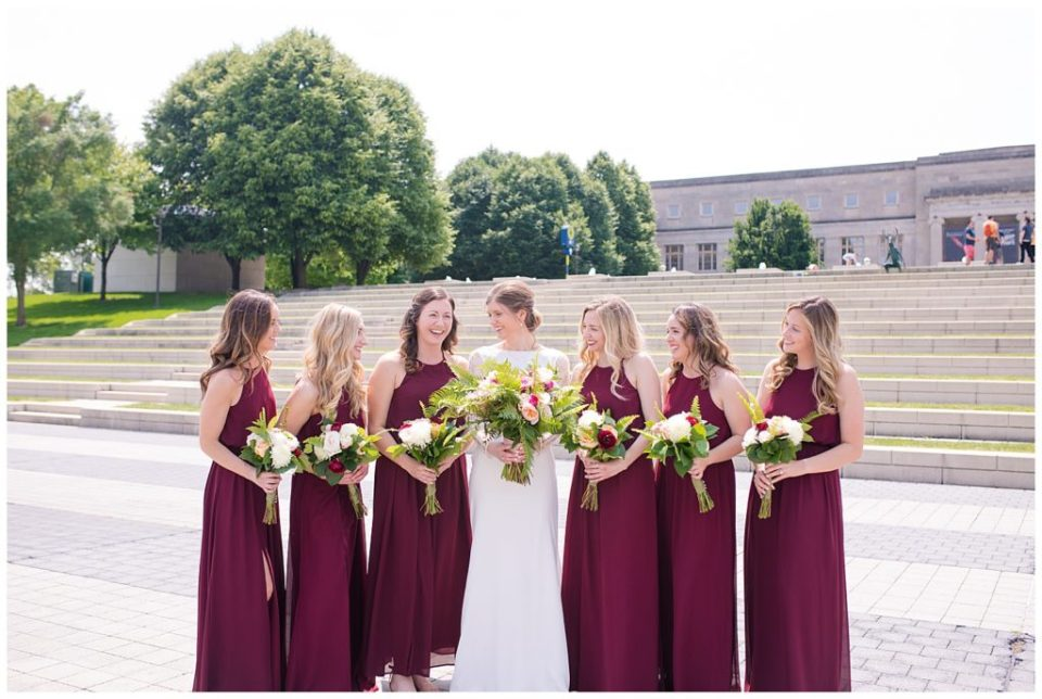 bride and bridesmaids laughing at each other at genoa park