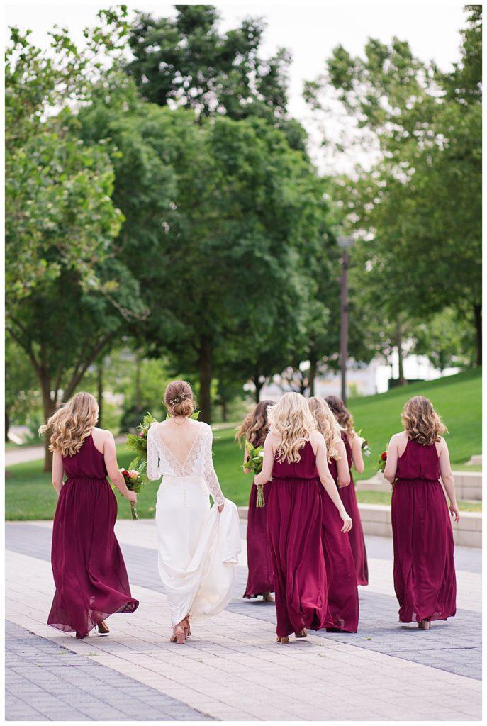 bride and bridesmaids walking at genoa park