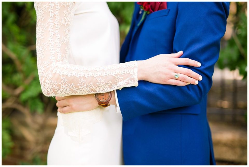 A picture of a closeup view of the bride and groom holding each other, showing the bride's beautiful ring at Dock 580 by Alayna Parker Photography  - Columbus  wedding photographer