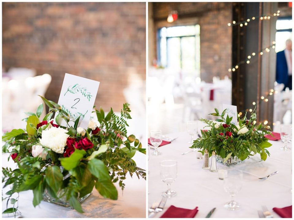 An image of a closeup view of a beautiful centerpiece on a guest table at the wedding reception, and a view of the table settings and lights at the reception at Dock 580 by Alayna Parker Photography  - Columbus Ohio