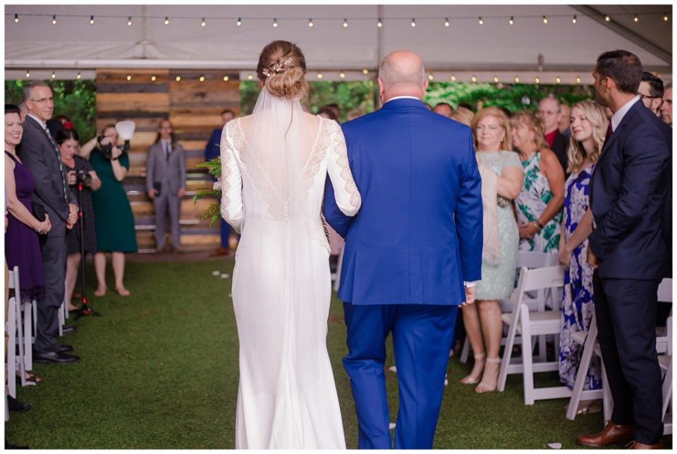 bride and father walking down the aisle at dock 580