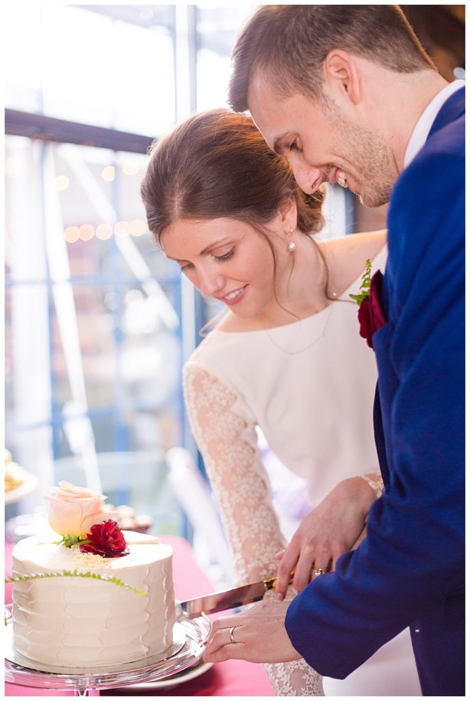 bride and groom cutting cake at dock 580