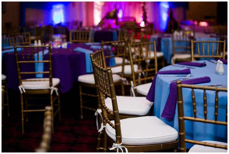 round tables with blue and purple tablecloths at bertram inn