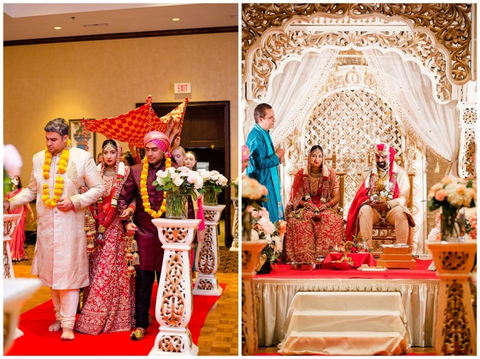 An image of an Indian bride and her family walking down the aisle for the Hindu wedding, and a view of the bride and groom seated under an elegant arch with the priest nearby at the Bertram Inn and Conference Center in Aurora by Alayna Parker  - Cleveland Ohio hindu marriage photographer
