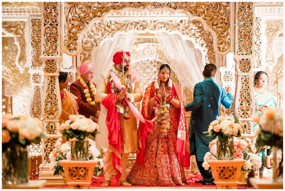 A picture of the Indian bride and groom standing as their Hindu wedding rituals are over at the Bertram Inn and Conference Center by Alayna Parker Photography  - Akron  wedding photographer
