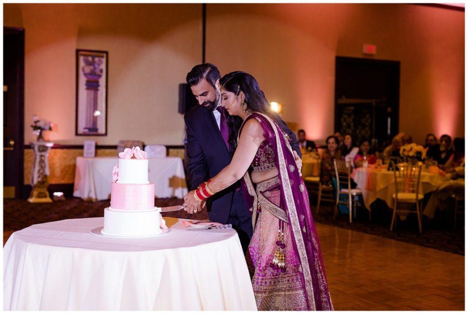 bride and groom cutting cake at bertram inn