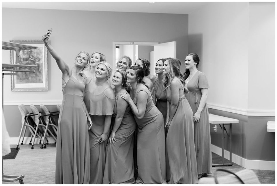 black and white image of bridesmaids taking selfie together