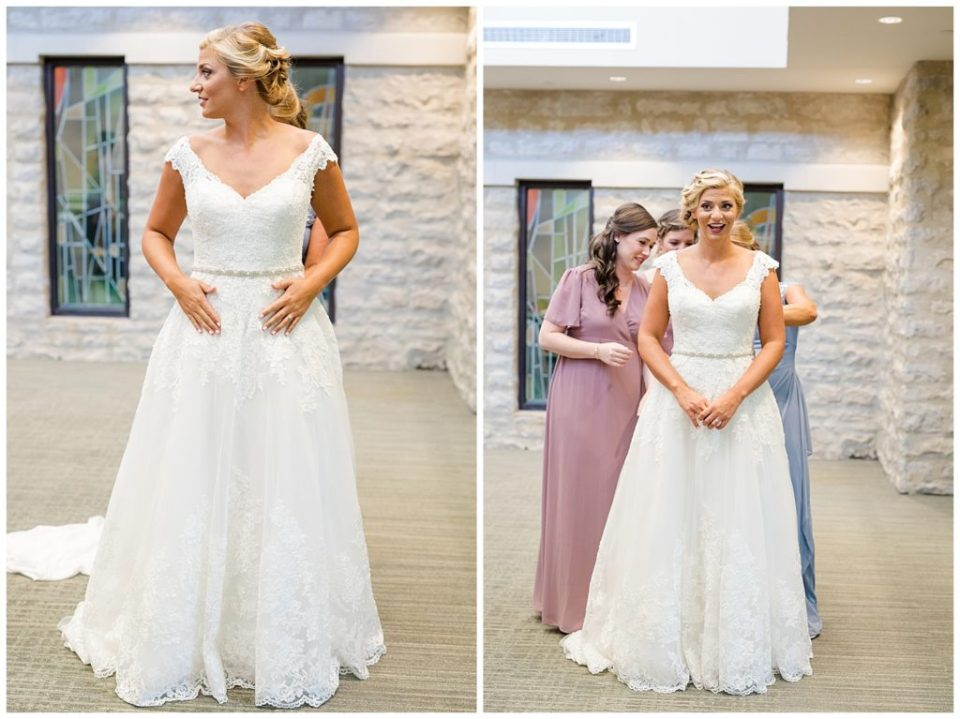 bride excited as she gets her wedding dress on