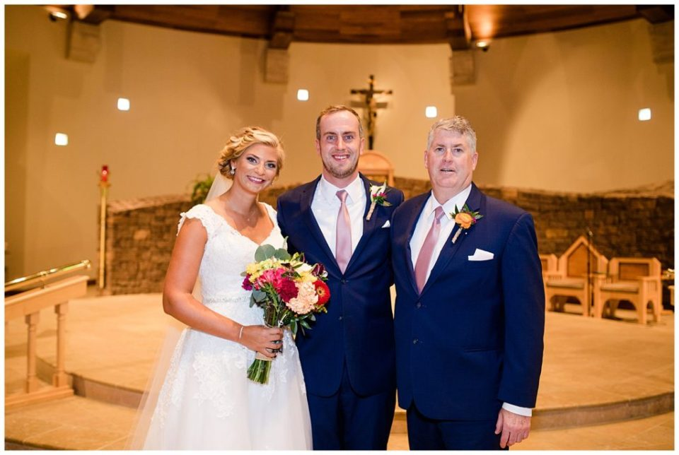An image of the bride and groom together with groom's father, happy together after the wedding at the St Andrew church in Columbus by Alayna Parker Photography  -   wedding photographers in Columbus Ohio