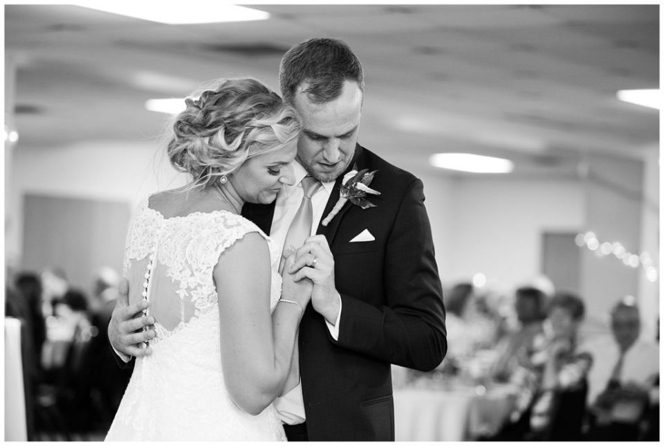 black and white image of bride and groom sharing first dance