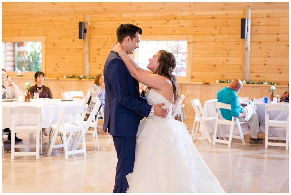 bride and groom share first dance at cedar grove lodge