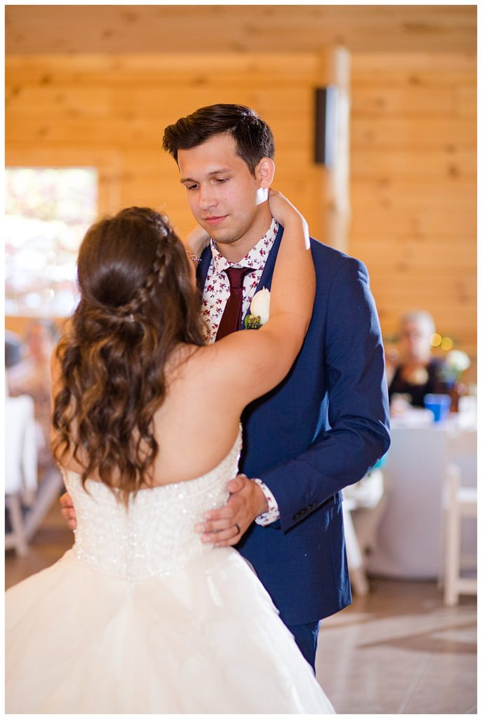 groom looking at bride during first dance