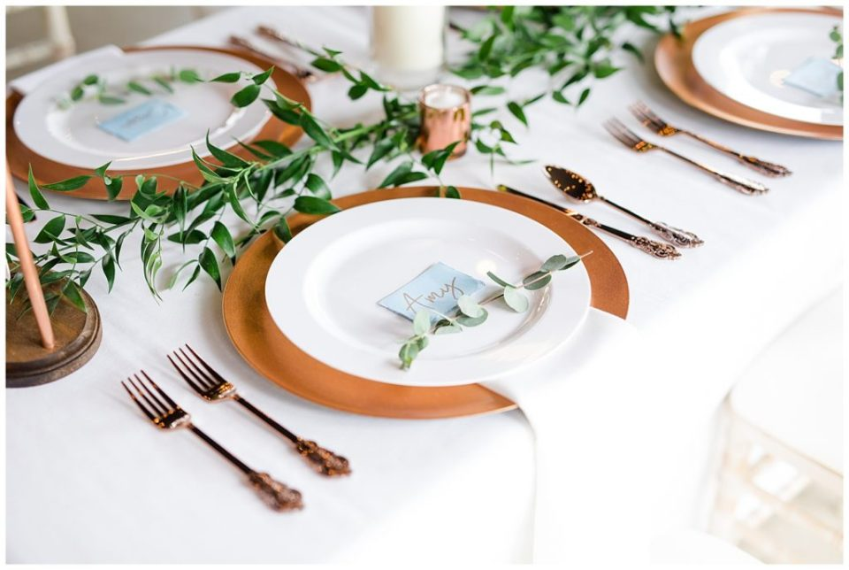 An image of a closeup view of a place setting at the wedding party table at the reception at the Oak Grove wedding venue by Columbus Ohio wedding photographer, Alayna Parker Photography