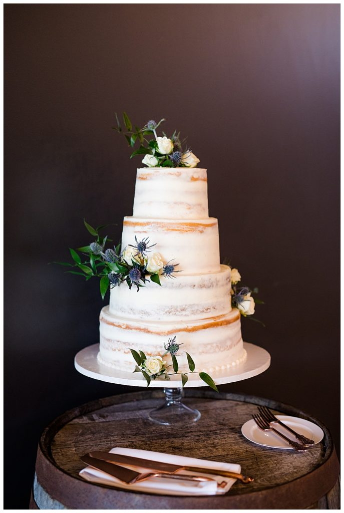 A photograph of a closeup view of the beautiful wedding cake at the wedding reception at the Oak Grove venue in New Albany, Ohio by Columbus OH wedding photographer, Alayna Parker Photography