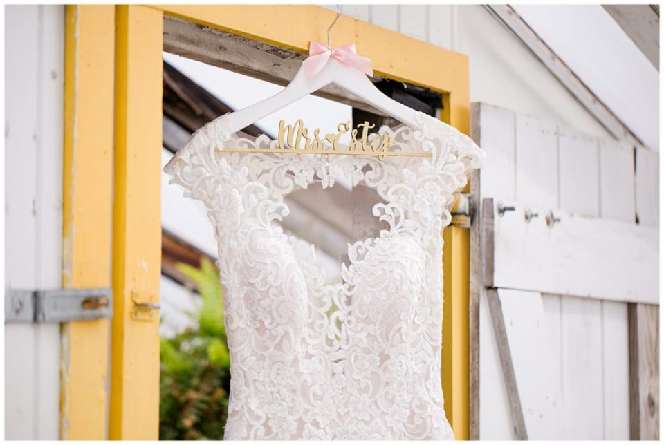 A picture of a closeup of the bodice of a bride's dress hanging, waiting for the bride to get dressed for the wedding ceremony at Jorgensen Farms wedding venue by Alayna Parker  - Columbus  wedding photography