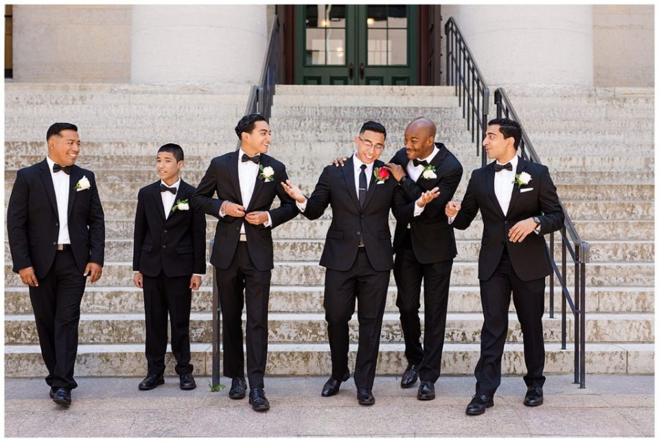 groom and groomsmen walking in front of steps at ohio statehouse