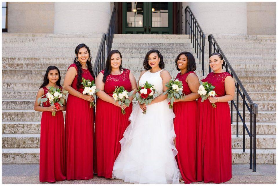 bride and bridesmaids smiling at camera at ohio statehouse