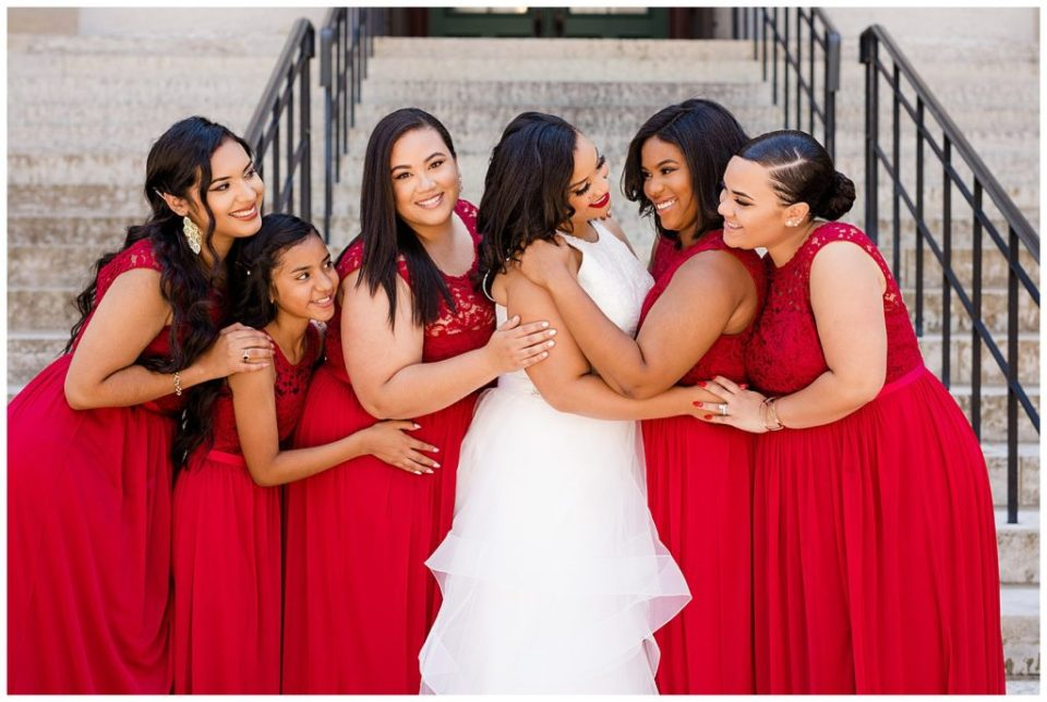 A picture of the bride talking and smiling with her bridesmaids as they line up all dressed for the wedding by Columbus  wedding photography specialist, Alayna Parker Photography