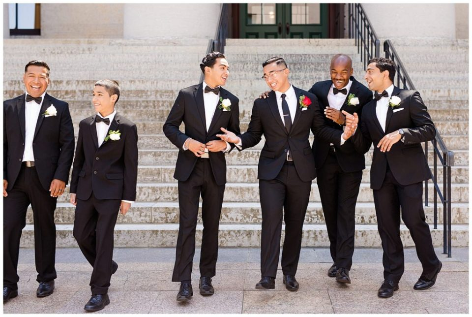 An image of the groom laughing with his groomsmen, lining up all dressed for the wedding by Columbus Ohio wedding photography specialist, Alayna Parker Photography