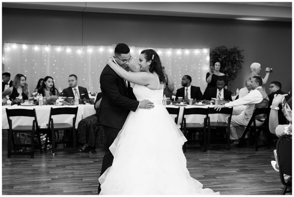 A picture of a black and white view of the first dance for the married couple at their wedding reception by Columbus  wedding photography specialist, Alayna Parker Photography
