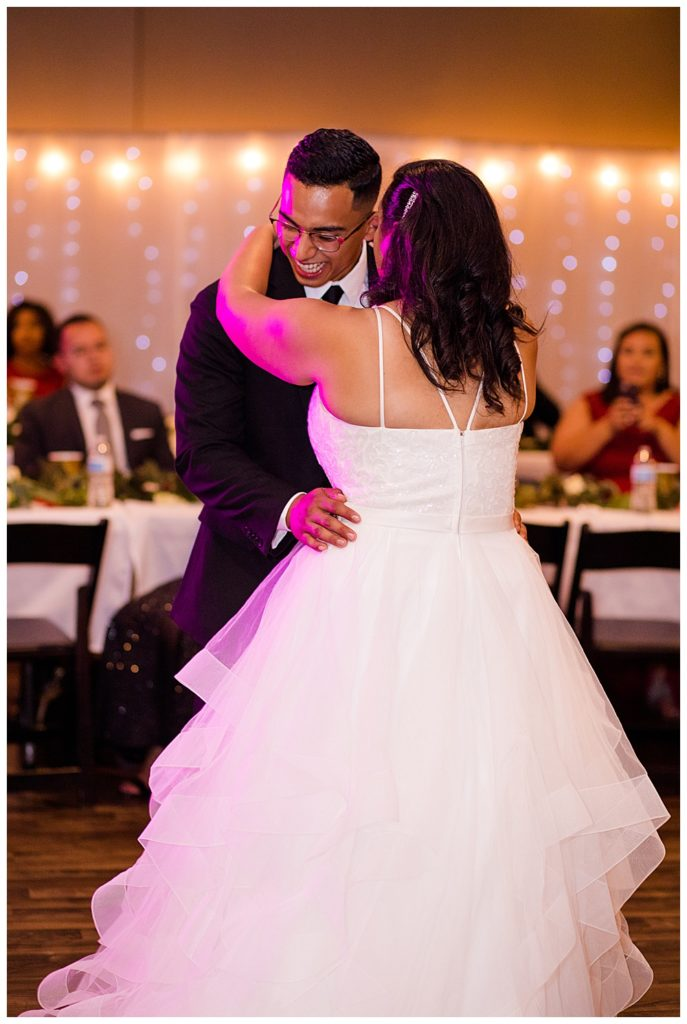 groom laughing as he dances with bride at stewart hall in obetz