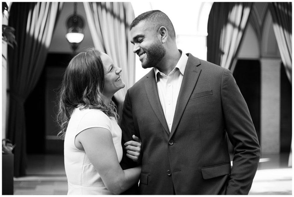 A picture of a closeup view in black and white of a couple newly engaged, holding each other and gazing happily at each other at the Columbus Museum of Art by Alayna Parker  - Columbus  engagement photography